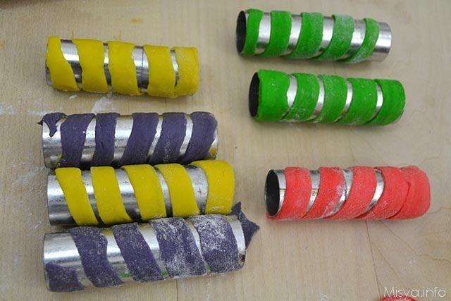 11 arrotolare attorno cilindro